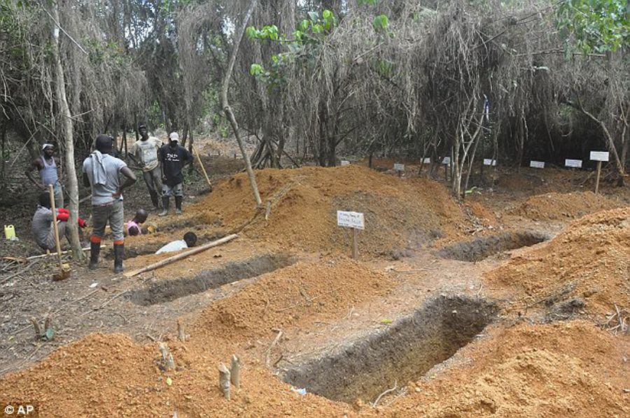 grave diggers creating graves to bury Ebola victims in Monrovia Liberia