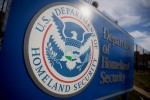 A U.S. Department of Homeland Security (DHS) sign stands at the headquarters in Washington, D.C., U.S., on Thursday, Dec. 11, 2014. The U.S. House is set to pass a $1.1 trillion spending bill that includes a banking provision opposed by many Democrats as a giveaway to large institutions. Current funding for the government ends today, and the measure would finance most of the government through September 2015. The DHS, responsible for immigration policy, would be financed only through Feb. 27. Photographer: Andrew Harrer/Bloomberg