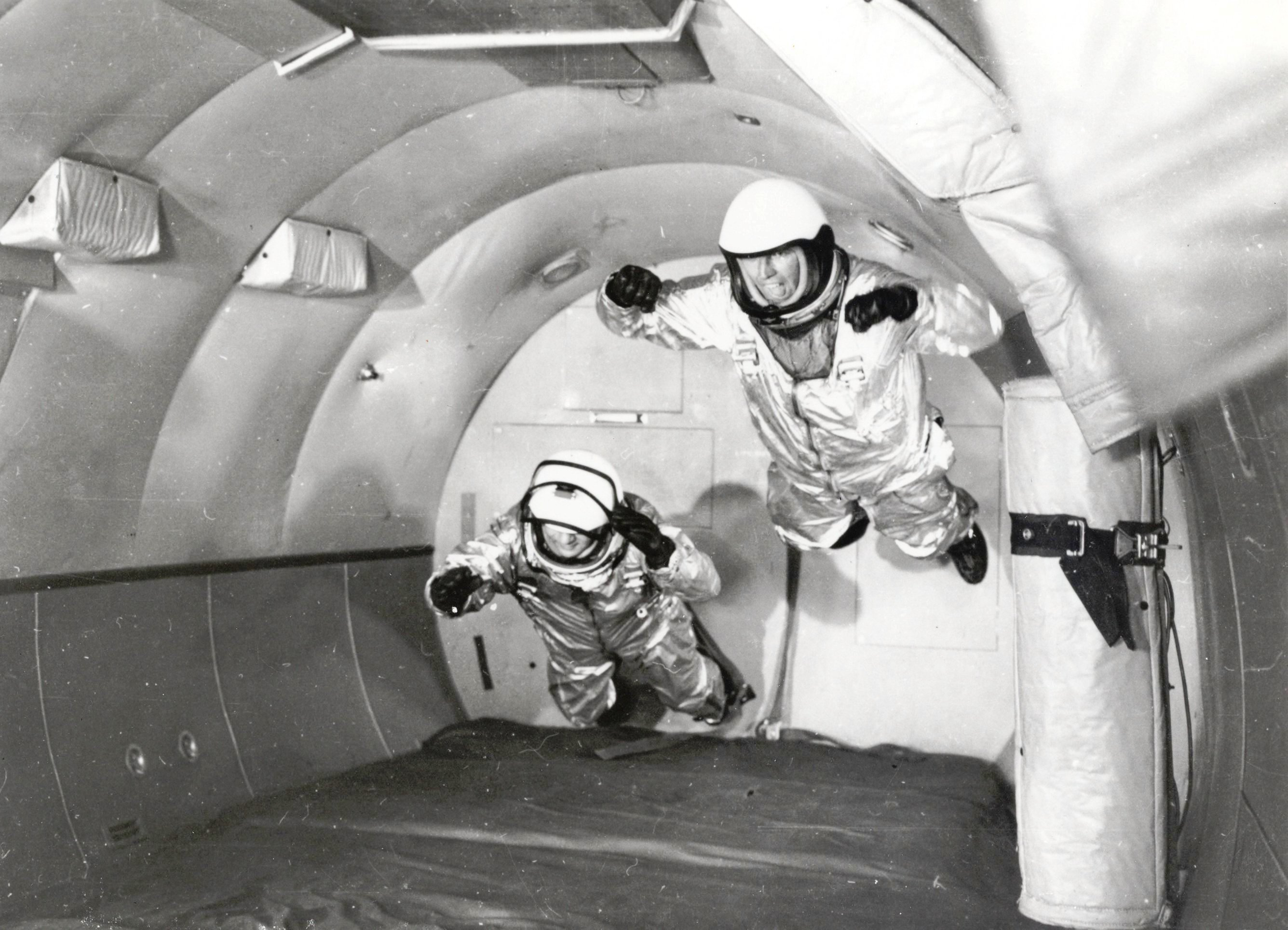 "Mercury Astronauts in Weightless Flight on C-131 Aircraft Full Description: Astronauts in simulated weightless flight in C-131 aircraft flying ""zero-g"" trajectory at Wright Air Development Center. Weightless flights were a new form of training for the Mercury astronauts and parabolic flights that briefly go beyond the Earth's tug of gravity continue to be used for spaceflight training purposes. These flights are nicknamed the ""vomit comet"" because of the nausea that is often induced. Date: 1959 http://www.nasaimages.org/luna/servlet/detail/nasaNAS~5~5~21814~126539:Mercury-Astronauts-in-Weightless-Fl"