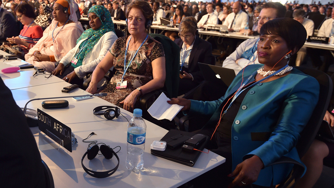 Attendees to the global climate talks in Lima, Peru go about their business at the